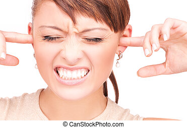 unhappy woman with fingers in ears - picture of unhappy...