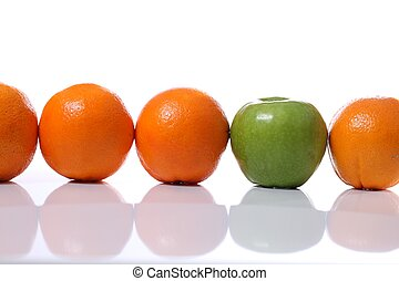 Misfit - Row of oranges infiltrated by a green apple