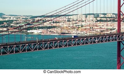 Traffic on the 25 de Abril Bridge in Lisbon Portugal -...