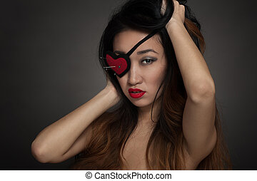 Woman with heart shape eye patch - Beautiful woman with...