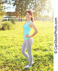 Sport, fitness concept - beautiful smiling woman preparing...
