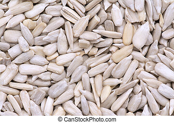 Sunflower seed background - Sunflower Seeds peeled shot as a...