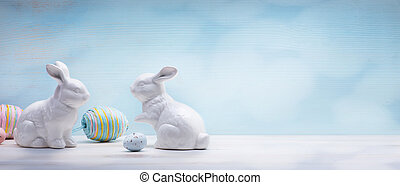 art Easter eggs and Easter bunny on wooden background