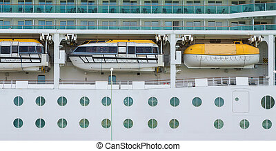 Three Lifeboats Over Portholes on Cruise Ship