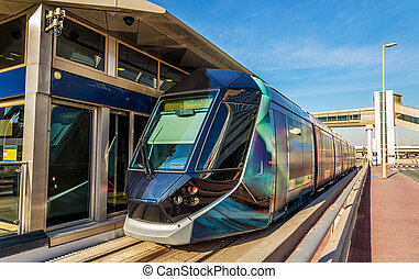Tram at an air-conditioned station in Jumeirah, Dubai
