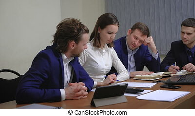 The team of young businesspeople. The meeting,...