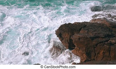 Ocean Waves Breaking on Rock, sunny weather