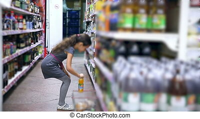 girl teen in supermarket to buy Juice water cola - girl teen...