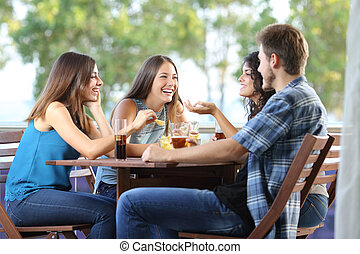 Group of friends talking and drinking at home - Group of...