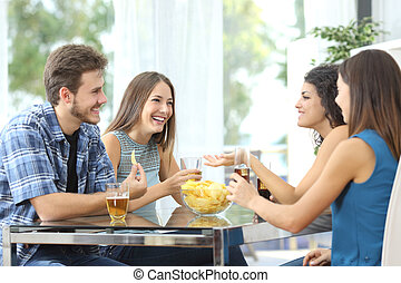 Group of friends talking at home - Funny group of 4 friends...
