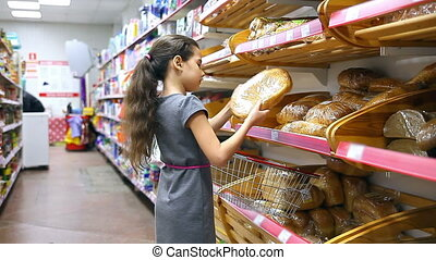 girl teen with in supermarket to buy baking bread food -...
