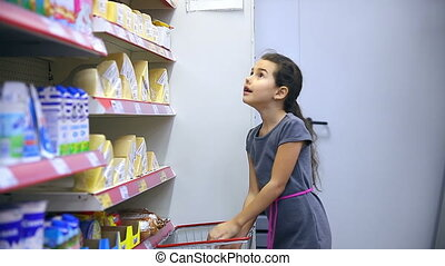 girl teen in supermarket to buy cheese food - girl teen in...