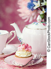 Afternoon tea served with a flower cupcake