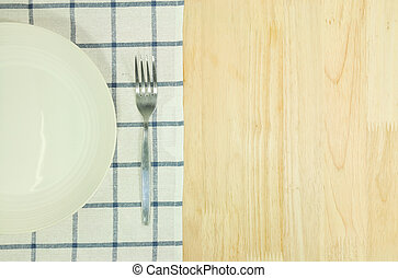 Blue tablecloth and white plate