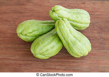 Chayote on wood background