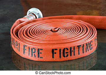 Firehose - A rolled up firehose used by firefighters