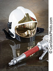 Materials for firefighters - A helmet and a nozzle used by...