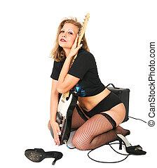 Rocker Girl Hugging Guitar - young caucasian in rocker style...