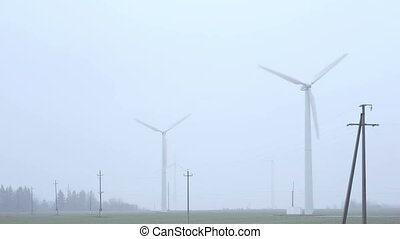 windmills near the road foggy morning. - windmills group...