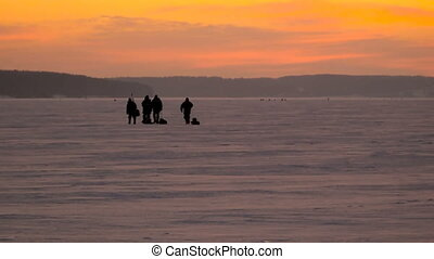 Dawn in the winter on the river Volga, fishermen go to fish