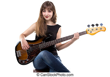 Teenage girl playing on bass guitar on white background