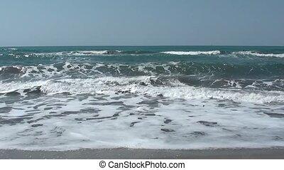 Sea washing shore one third - Sea washing shore on the sandy...