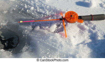 Winter fishing rod and fish on ice - Ice-hole and fishing...