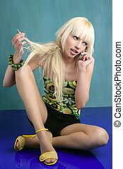 blonde fashion teen talking mobile phone green background