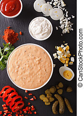 Thousand Island Dressing with ingredients close-up vertical...