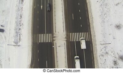 Aerial shot of highway with cars in winter