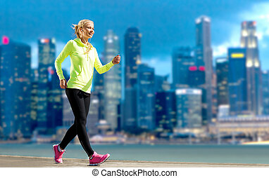 happy woman jogging over city street background - fitness,...