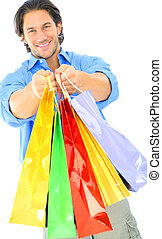 Attractive Young Man Offering Shopping Bags - happy young...