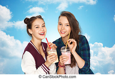 happy pretty teenage girls drinking milk shakes - people,...