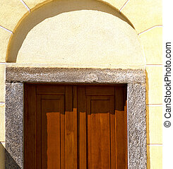 cairate abstract a door curch closed wood italy lombardy -...