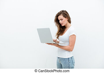 young woman holding a laptop on white