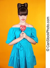Heart Lollypop Beautiful teen girl with colourful lolli pop...
