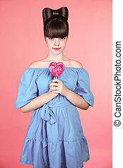 Lollypop Beautiful teen girl with colourful heart lollipop...