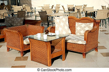 Rattan Chairs in hotel restaurant - Rattan Chairs and...