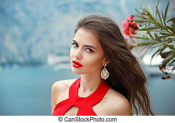 Beautiful girl with red lips, long wavy hair and fashion...