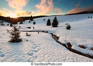 sunset over mountain river in winter, Baden-Wurttemberg,...