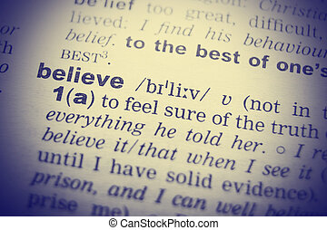 Close-up of word in English dictionary Belief, definition...