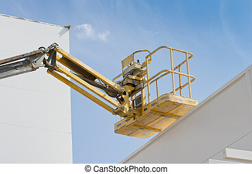 Construction lift platform with cage for worker safety...