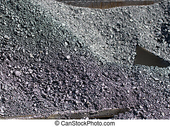 Asphalt texture - Close up of fresh asphalt on pile in...