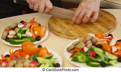man cutting vegetables for salad