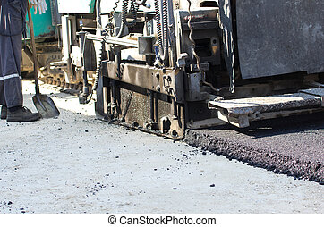 Asphalt finisher machine - Close up of paving machine laying...