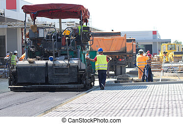 Asphalt finisher machine - Paving machine laying fresh...