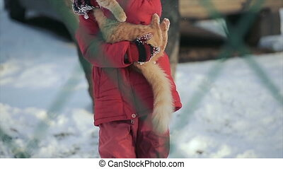Young girl with a cat on a winter day