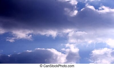 Rolling clouds time lapse - Rolling clouds in the blue sky,...