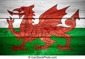 Welsh flag - flag of Wales or Welsh banner on wooden...