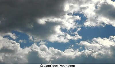 Rolling clouds timelapse - Rolling clouds in the blue sky,...